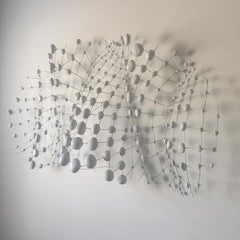 Contemporary white minimalist wall sculpture made from natural materials