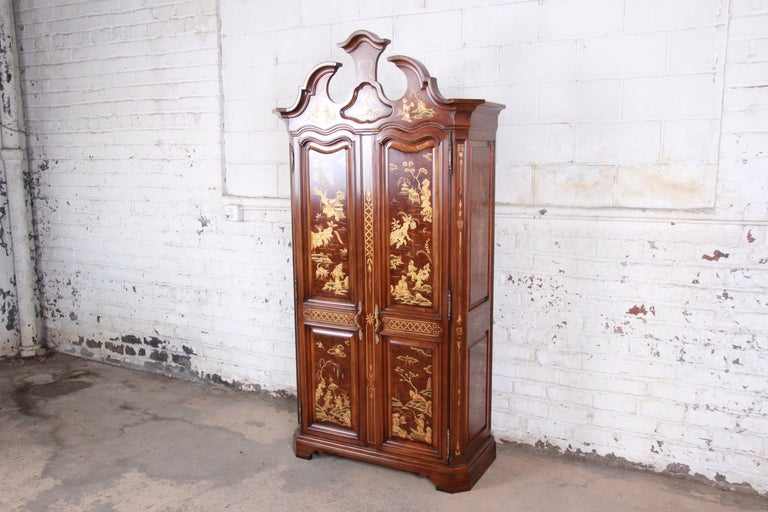 A rare and exceptional Hollywood Regency Chinoiserie armoire dresser  Made by Karges Furniture  USA, circa 1980s  Burlwood + cherry + figurative Asian scenes  Measures: 44.75