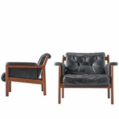 Karl-Erik Ekselius Black Leather and Teak Lounge Chairs