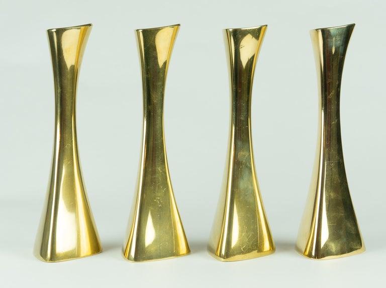 Karl-Erik Ytterberg, Set of Four Brass Candlesticks, Sweden, 1960s   Description Set of four brass candlesticks designed by Karl-Erik Ytterberg, produced by BCA Eskultina Sweden in the 1960's.  The candlesticks are monogrammed