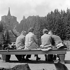 Couples on a bench in front of a statue in Kassel, Germany 1937 Printed Later