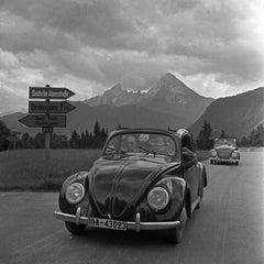 People traveling in Volkswagen beetle, Germany 1939 Printed Later