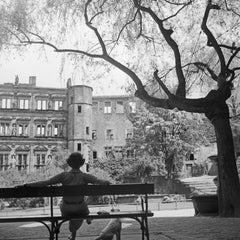 Woman on bench in front of Heidelberg castle, Germany 1936, Printed Later