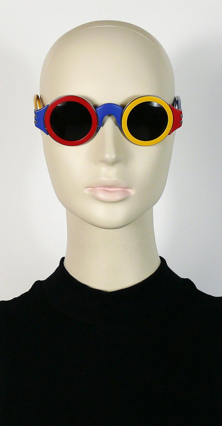 KARL LAGERFELD vintage rare and collectable colourful sunglasses in shades of red, yellow and blue featuring round lenses and silver toned hardware with engraved KL.  Limited edition. Numbered Nr. 1437.   Signed KARL LAGERFELD on the inside