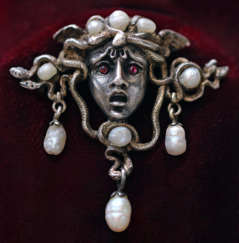 A fabulous example of a 'fin de siècle' symbolist jewel.  Medusa the original 'Femme Fatale' is beautifully portrayed in this exquisite brooch.  The powerful protective significance of the Greek Myth has fascinated artists for millennia. There are