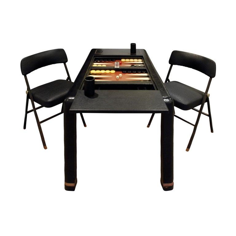 """Backgammon table in ostrich skin with brass banding and matching folding chairs in embossed ostrich leather by Karl Springer, American 1970s (signed on bottom with a paper label that reads """"Karl Springer""""). Game table in leather with original game"""