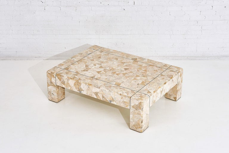 Karl Springer brass and tessellated travertine coffee table, circa 1970s.