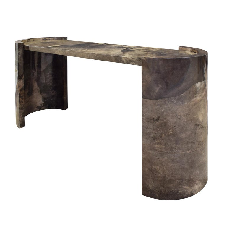 Impressive console table in dark lacquered goatskin with racetrack top and curved sides by Karl Springer, American 1980. Dated on bottom. This table exemplifies the impeccable craftsmanship of Karl Springer.