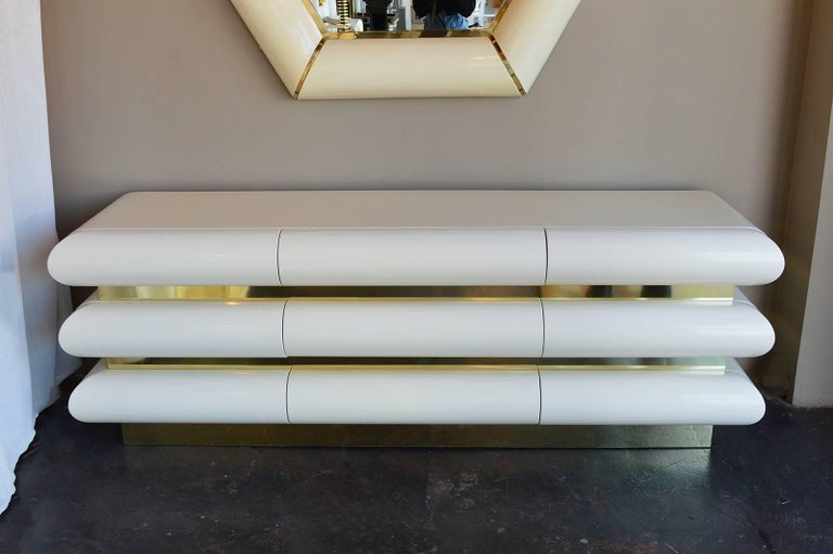 Midcentury nine drawered credenza. High gloss and brass.
