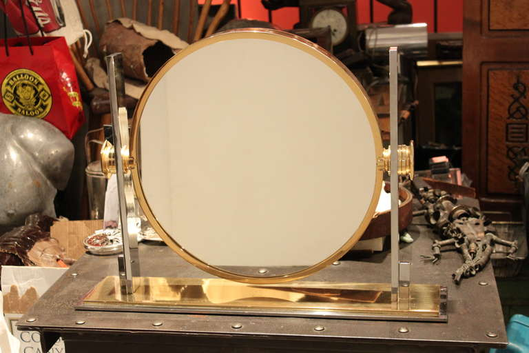 This is a fine example of what is arguably one of Karl Springers most iconic designs. These mirrors are typically found in the smaller size. This is the medium-sized example. These are 2 sided and super heavy quality. This example is in excellent