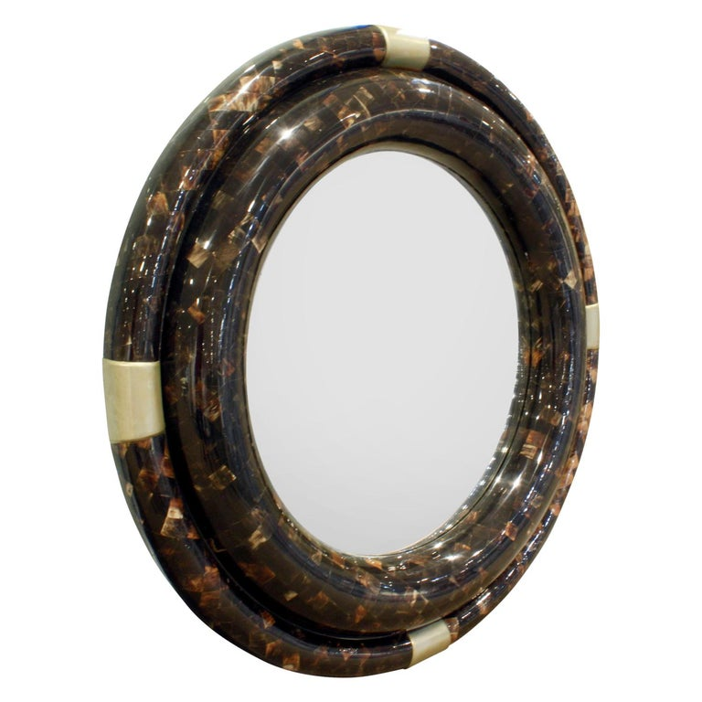 Round wall hanging mirror with 2 concentric rings in tessellated horn with bronze accents by Karl Springer, American, 1970s.