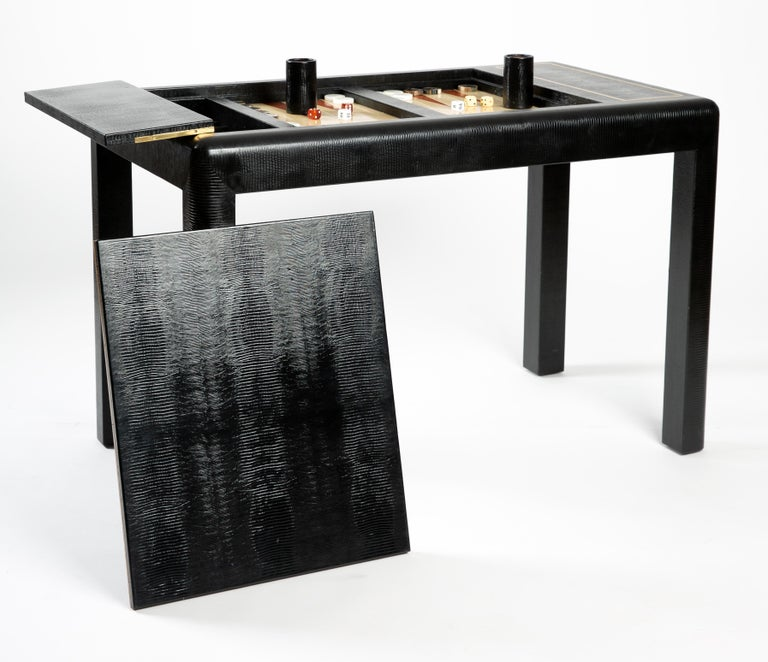 Karl Springer leather-clad Backgammon game table from the 1980s with embossed and inlaid leather. All game pieces included. Side compartment opens for storage and top is removable. Measures: 44 x 26 x 29 H.