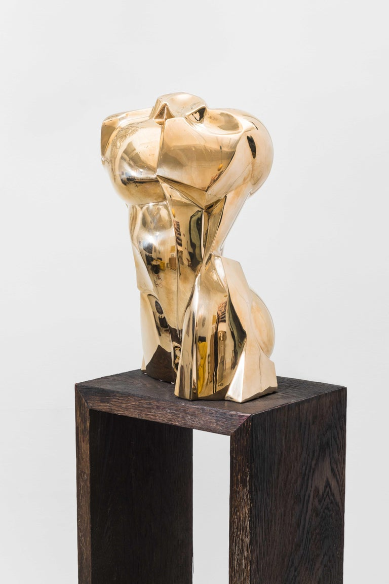Karl Springer commissioned this cast bronze cubist Torso Sculpture by artist Roberto Esteves, circa 1982. The limited edition sculpture was sold exclusively through the Karl Springer show room and is now available for the first time in collaboration