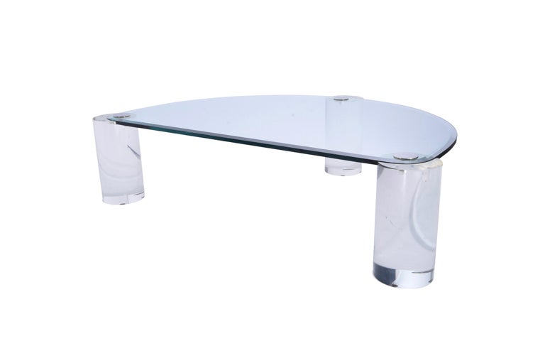 Lucite sculpture leg coffee table by Karl Springer with glass top.