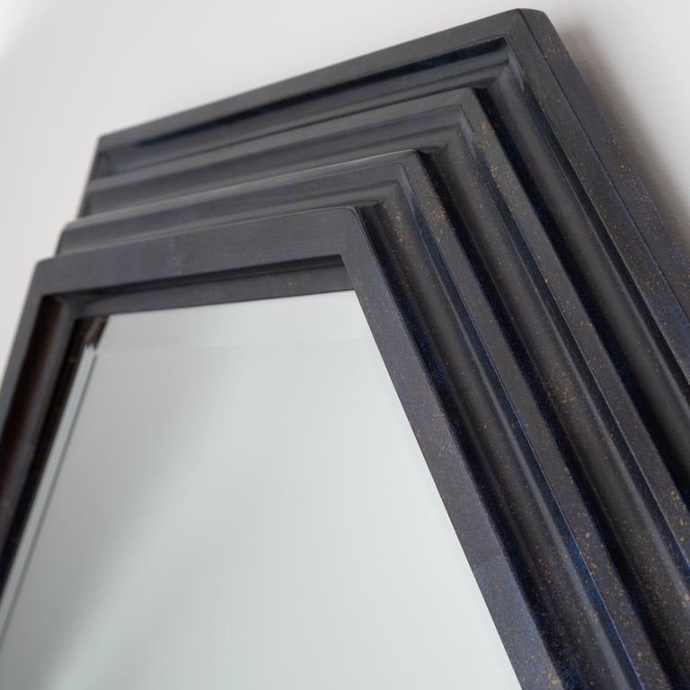 Gorgeous, grand-scale Karl Springer octagonal mirror with a deep, tiered wooden frame in a faux lacquer finish that mimics the semi-precious stone lapis lazuli. This deep-blue finish includes subtle faux seams where separate pieces of the