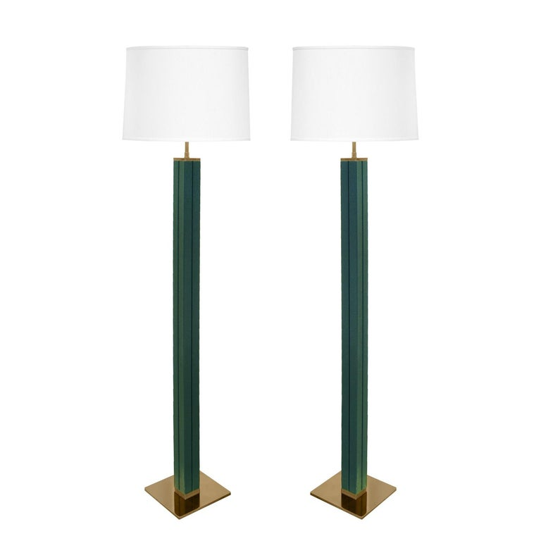 Exceptional pair of floor lamps with square channeled columns covered in forest green embossed emu leather with polished brass bases and hardware by Karl Springer, American 1970's.  Reference: Karl Springer LTD small paper catalog published in