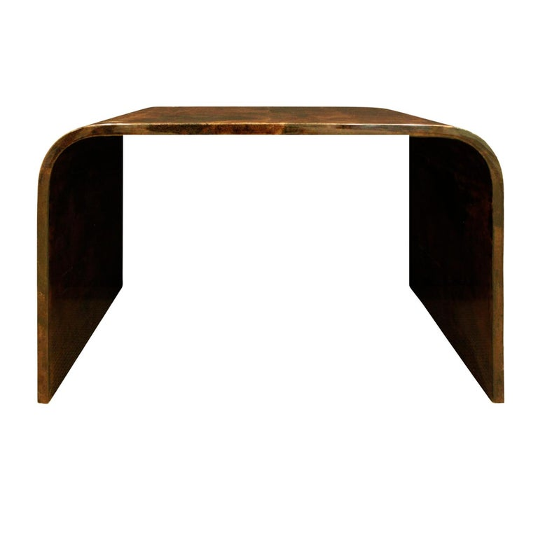 Petit waterfall coffee table in lacquered goatskin by Karl Springer, American, 1970s. The underside of the table is also finished in lacquered goatskin. The quality of this table is extraordinary.