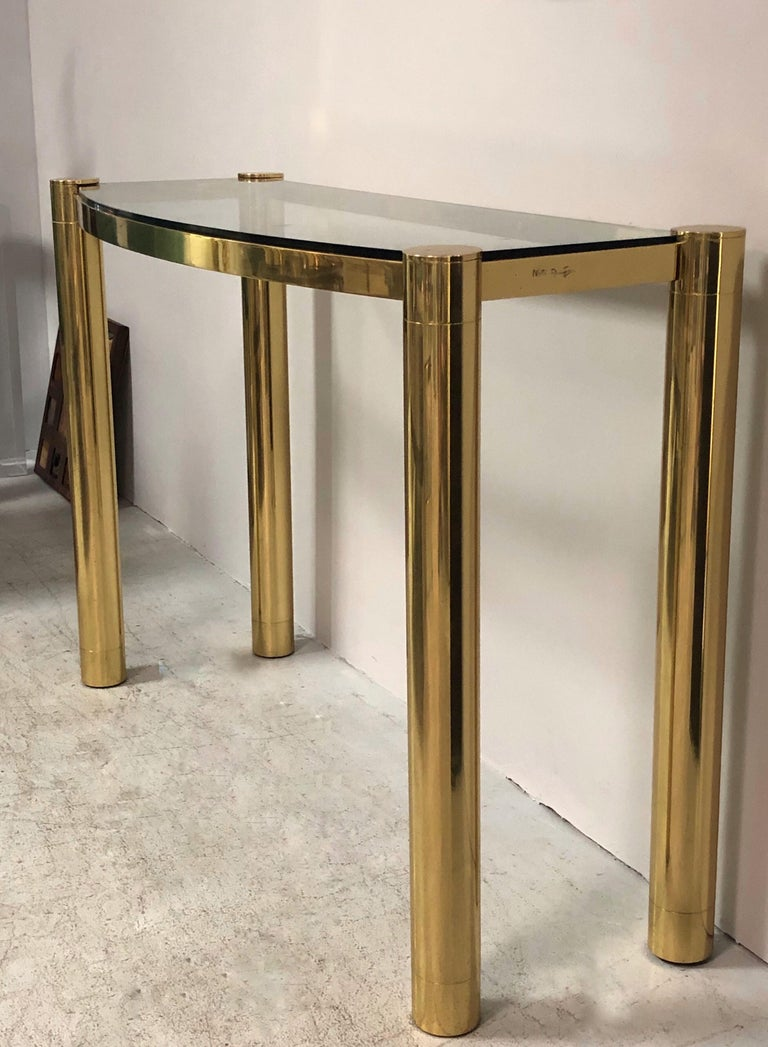 A solid bronze console with glass top by Karl Springer. Exquisitely crafted. Signed on edge. The design is subtle with quite lines that are complemented by the richness of the chosen material.