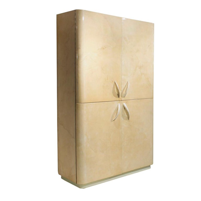 Rare large 4-door cabinet covered in lacquered goatskin with animal horn handles by Karl Springer, American 1970s. It is currently designed for a TV on top and has deep drawers on the bottom. We can refit the interior spaces to spec. This piece is