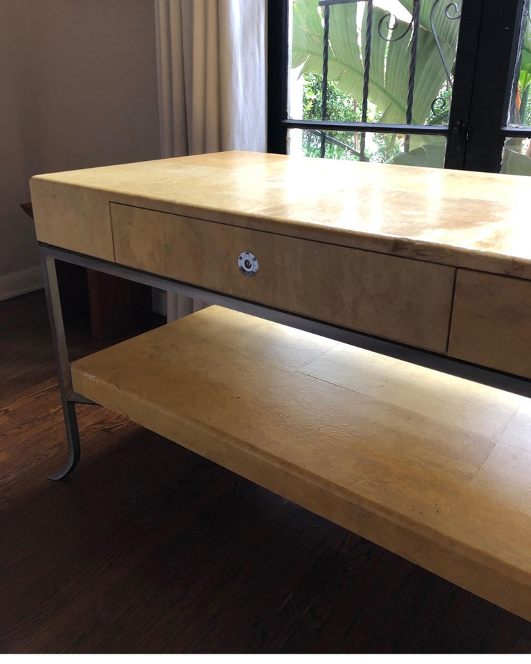 Handsome and unique Art Deco console table.  Steel base with Parchment wrapped top. Nickel Hardware. Karl Springer - Samuel Marx - Gio Ponti - Aldo Turo style  Condition consistent with age. Some fading/nicks to parchment and pitting on steel base.