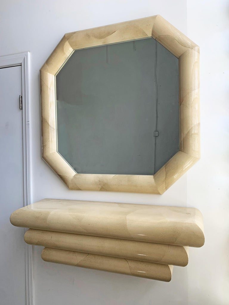 This 1980s mirror and matching console are simply stunning. The mirror bears a