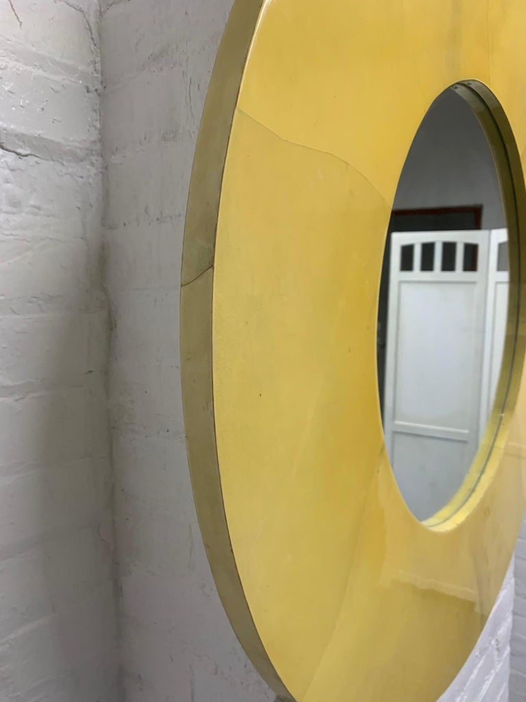 Round lacquered goatskin mirror in the style of Karl Springer.