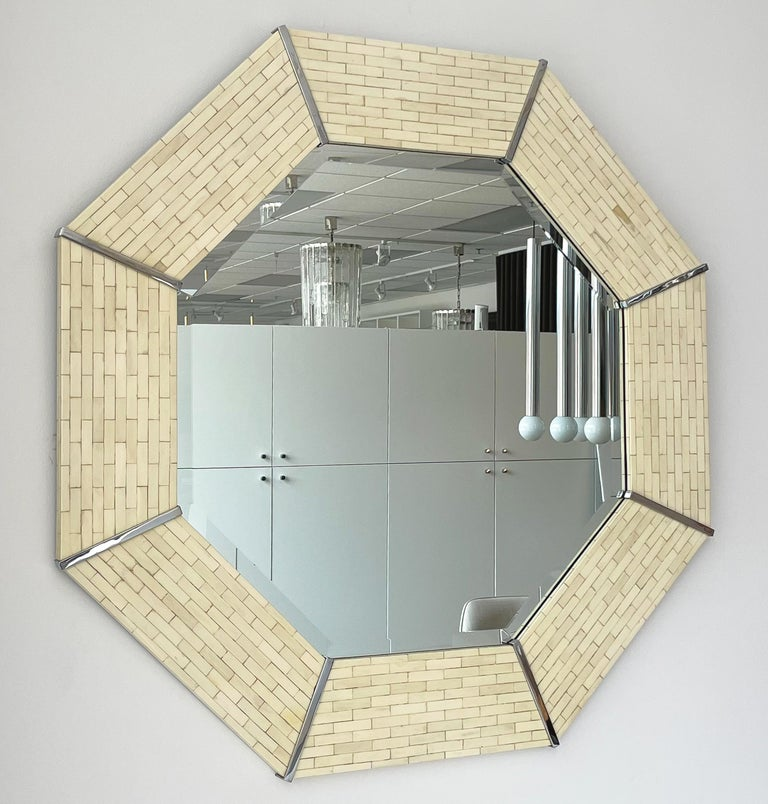 A Karl Springer tessellated bone and chrome octagon wall mirror, circa 1970s. Stylish and large this 42
