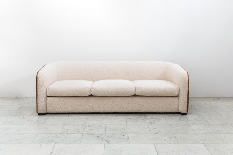 """This one-of-a-kind, zebra-wood sofa from Karl Springer was a custom commission based on Springer's popular """"Pullman Sofa."""" The Pullman Sofa features a wrap around, flat back that curves gently into armrests.  Its low profile and rich, book-matched"""