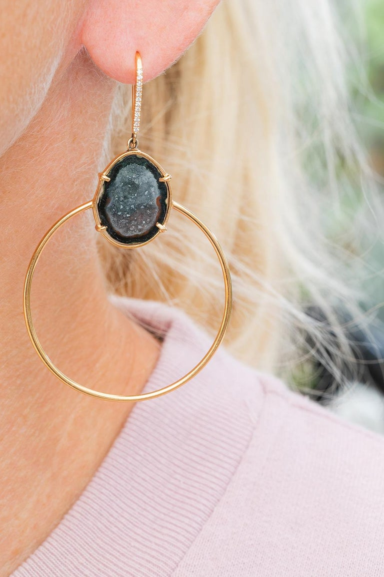These Jade earrings are the perfect mix of classic and modern. Handcrafted in 18 k rose gold and diamonds on the hooks. The geodes have grey, black and red colors inside. There shape is elegant enough for evening yet simple enough for every day.
