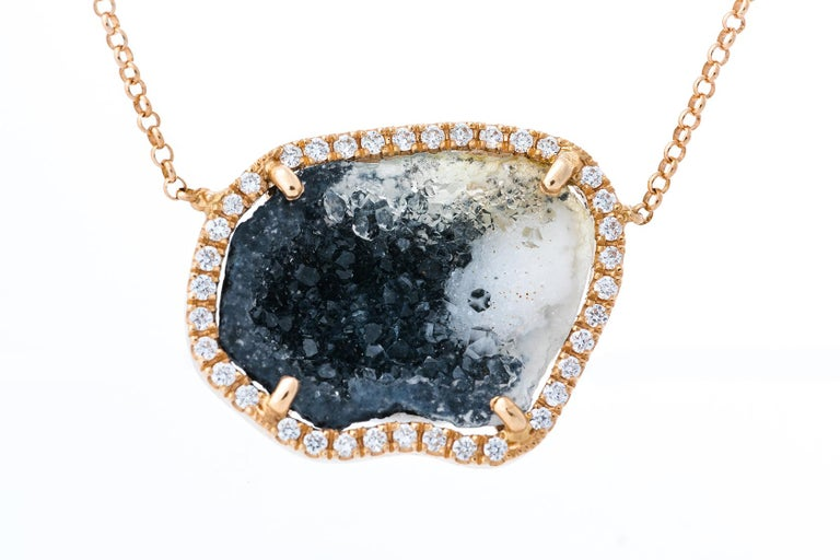 This 18 k rose gold Black/yellow/white Agate pendant has 0.23 ct of dazzling diamonds. This is the perfect gift for yourself or a special person. The chain is attached and is 45 cm and adjustable with a sliding ball system.