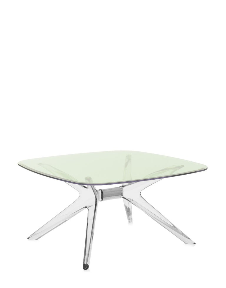 Kartell lifestyle enhances the living room with Philippe Starck's Blast, a coffee table square with rounded corners and clear bases and tops. The design is a development of the Sir Gio table. The central core of the base is