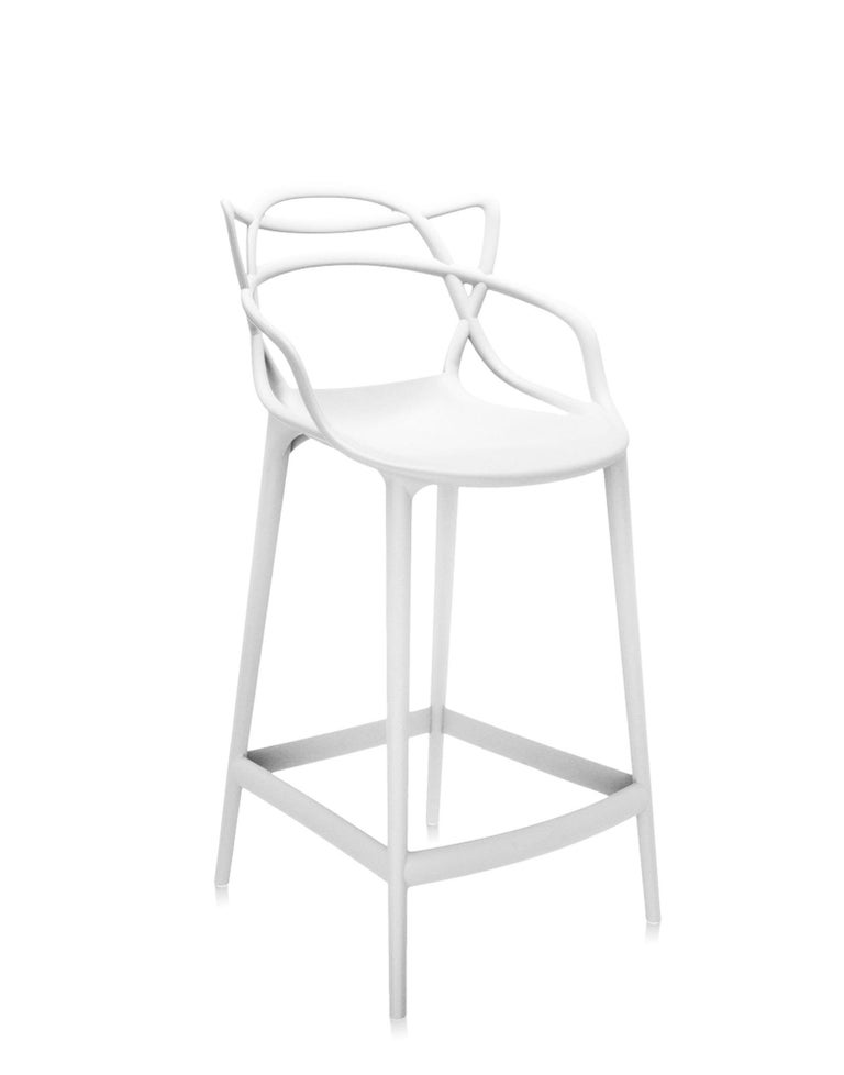 Kartell also offers a stool version of the Masters chair, winner of the Good Design Award 2010 and the Red Dot Award 2013, and a worldwide best seller. The legs are lengthened and the seat is shrunk, but the frame's unmistakable graphic look,