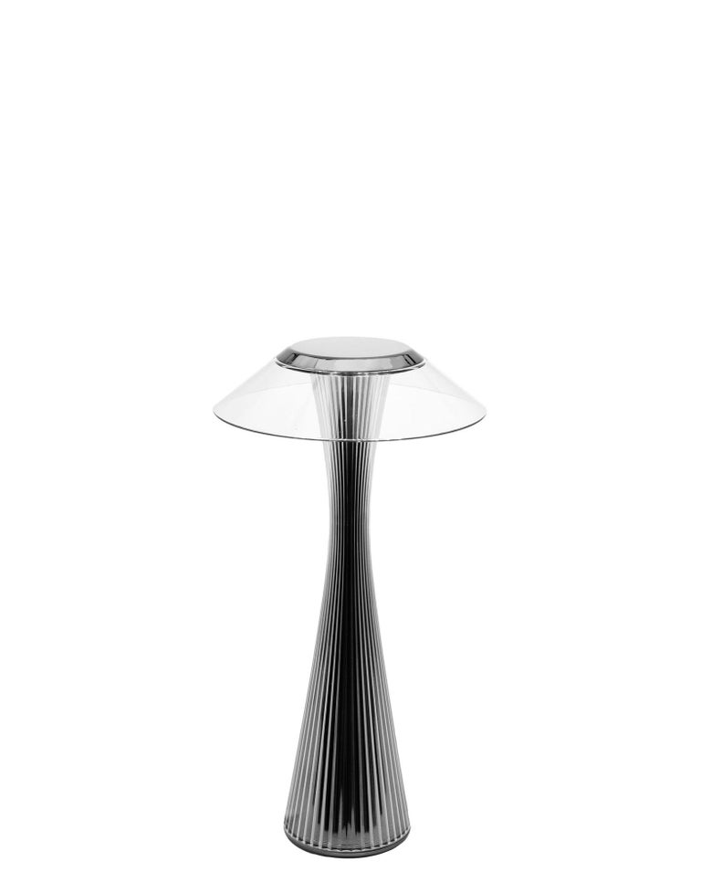 "A table lamp made of transparent plastic with an elongated shape: the silhouette recalls the shapes of the Space Needle, the tower that made the Seattle skyline famous. ""In designing the 'Space' Lamp, we drew inspiration from the futuristic spirit"