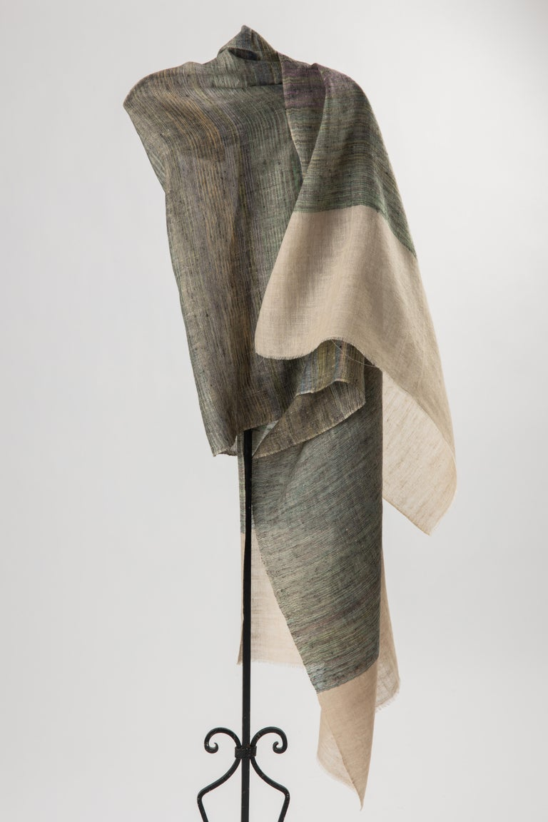 Lovely soft palette Kashmiri India shawl hand woven in variegated aqua, lavender, natural dark and ivory 100% cashmere wool. Falls perfectly across the body, light and warm. This piece is hand crafted on a loom, and has minor uneven width, as seen