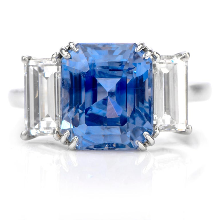 Rare Sapphire!  All Natural No Heat  Sapphire from Kashmir region  GIA certified. This very rare sapphire ring was inspired in a  3 stone motif and crafted in luxurious Platinum. Featuring a Step cut rectangular  shaped natural Kashmir sapphire All