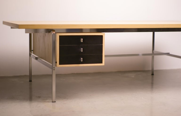 Large natural ash and black dye ash executive writing table with matte chrome steel base and pulls, designed by Preben Fabricius and Jorgen Kastholm for Kill International. Beautiful original condition.