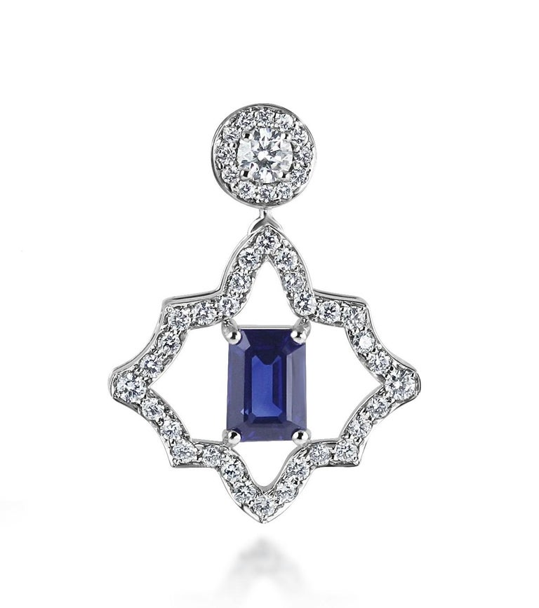 A stunning pair of diamond & sapphire stud earrings with a never ending, infinity, line of diamonds surrounding the central sapphire.  The earrings have movement to them, allowing them to sparkle even more!    This is a very beautiful and intriguing