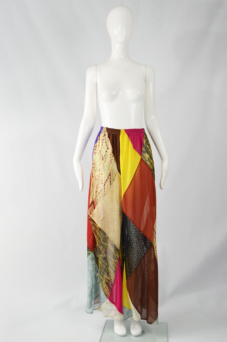 """Size:  Marked M Waist - Stretches from 28-36"""" / 71-91cm Hips - Free Rise - 14"""" / 35cm Inside Leg - 30"""" / 76  A super rare and incredible pair of vintage women's wide leg palazzo pants from the 90s by iconic British fashion designer, Katharine"""