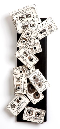 """Private Life"" porcelain, black stain ceramic wall sculpture of cassette tapes"
