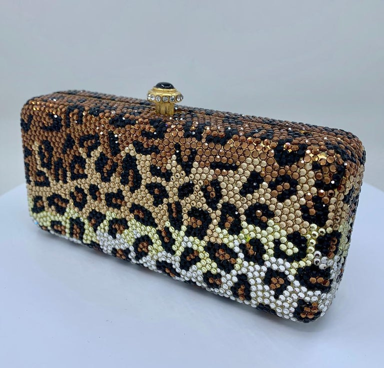 Exquisite handmade couture designer, Kathrine Baumann, who is the celebrated handbag maker to the stars, leopard pattern minaudière, evening bag or evening clutch is completely covered in fine quality Swarovski crystals. Gold toned metal frame with