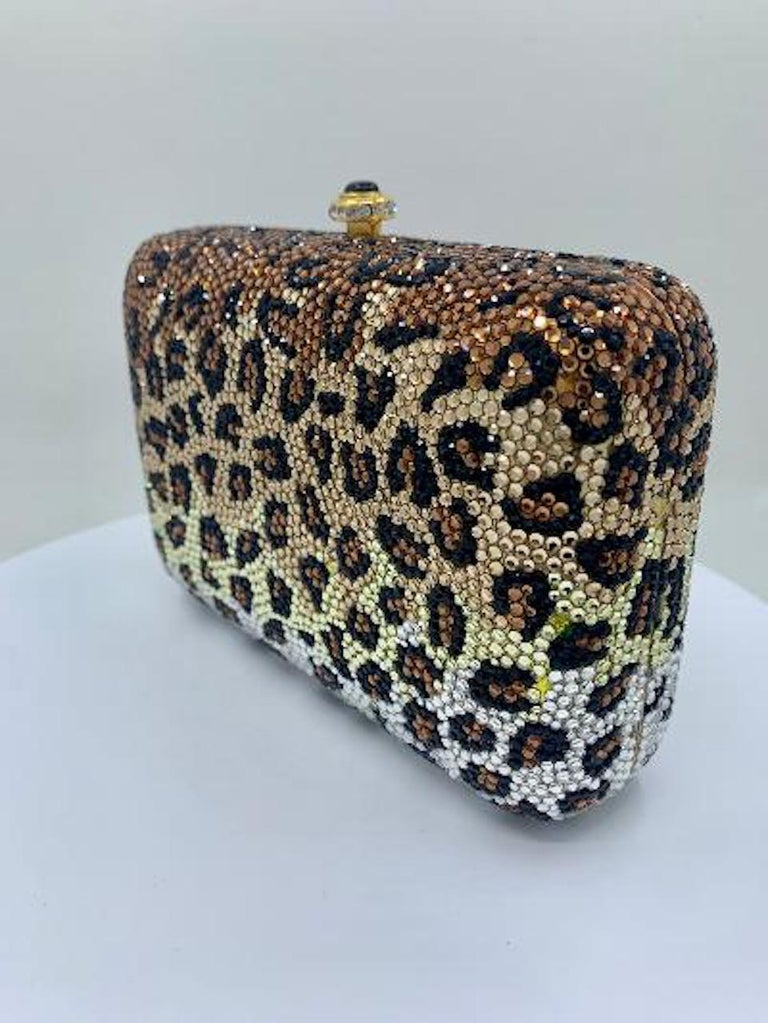 Exquisite handmade designer, Kathrine Baumann, who is the celebrated handbag maker to the stars, leopard pattern pillow shaped minaudière, evening bag or evening clutch is completely covered in fine quality Swarovski crystals. Gold toned metal frame