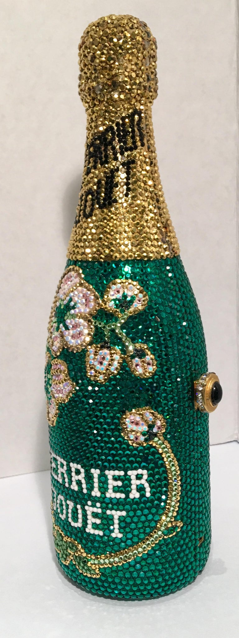 A limited-edition, signed and numbered, Swarovski crystal encrusted, gold-plated metal Perrier Jouet (Trademarked) French champagne split bottle shaped minaudière evening bag purse by Kathrine Baumann, who is the celebrated handbag maker to the
