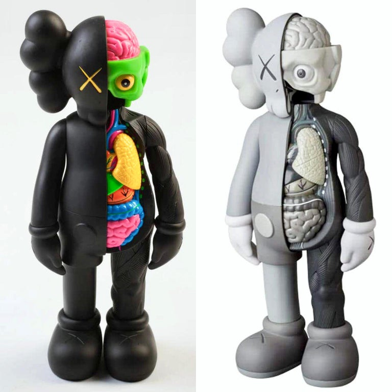 KAWS Flayed Companion: Set of 2. Each, new and sealed in their original packaging. Published by Medicom Japan in conjunction with the exhibition, KAWS: Where The End Starts at the Modern Art Museum of Fort Worth in 2016. These figurines have since