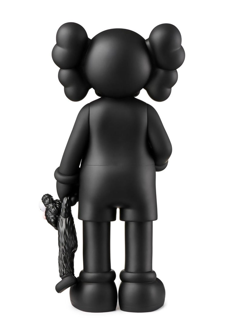 KAWS SHARE (Black), new & unopened in its original packaging.   Medium: Painted Vinyl Cast Resin.  12.4 x 6.3 inches.  New, unopened in its original box; excellent condition.   From a sold out edition of unknown. Stamped to the underside of foot.