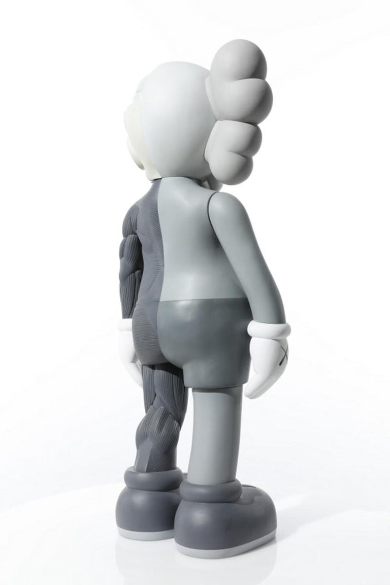 Painted cast vinyl sculpture. Stamped with the artist's name and date '© KAWS..09' on the underside of the figure's right foot. Stamped with the date and 'MEDICOM TOY 2009 MADE IN CHINA' on the underside of the figure's left foot. Executed in 2009,