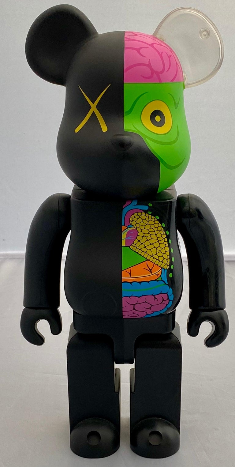 KAWS Dissected Black Bearbrick 400%, 2010: A collaboration between KAWS' OriginalFake brand and Medicom, this much sought-after black dissected KAWS Be@rbrick figure, is made from cast vinyl and features the artist's signature