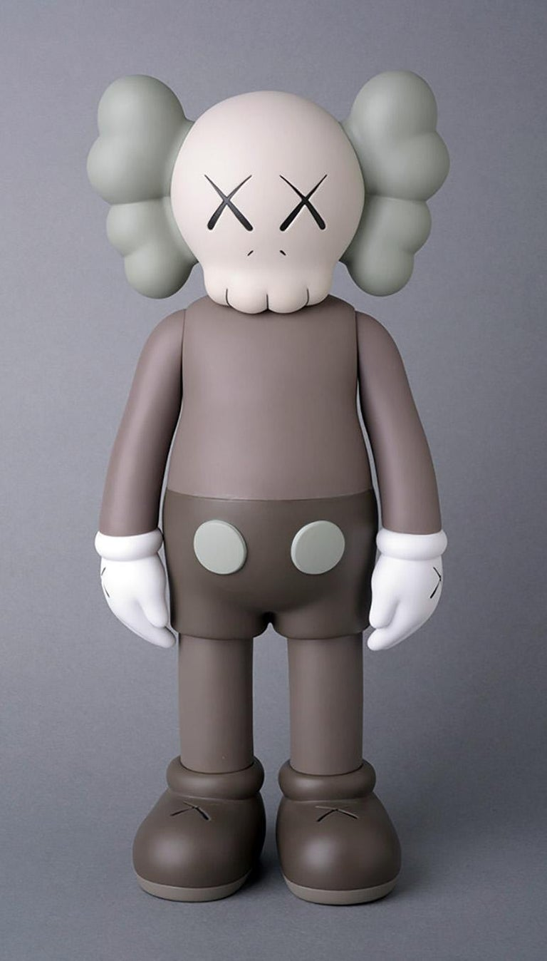 KAWS Companion 2016-2019: A curated set of 4 individual Brown KAWS Companions new & unopened in original packaging. Dimensions as follows:  KAWS Clean Slate, 2018: 14.25 x 8 x 8 inches.  KAWS Brown Companion 2016: 11 x 5 inches.  KAWS Along The Way