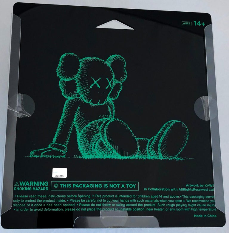 KAWS Black Holiday Companion (KAWS Taipei)  This figurine features KAWS' signature character COMPANION in a resting seated position. This figurine was published by All Rights Reserved to commemorate the debut of KAWS' largest sculptural endeavor to