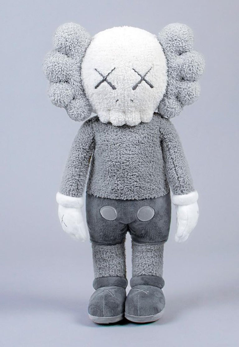"""KAWS Plush Holiday Companion Limited Edition:  This 20"""" grey KAWS plush was published to commemorate the debut of KAWS' floating art piece in Hong Kong during Hong Kong Art Basel 2019. New with tags complete with an authenticity card. A well-sized"""