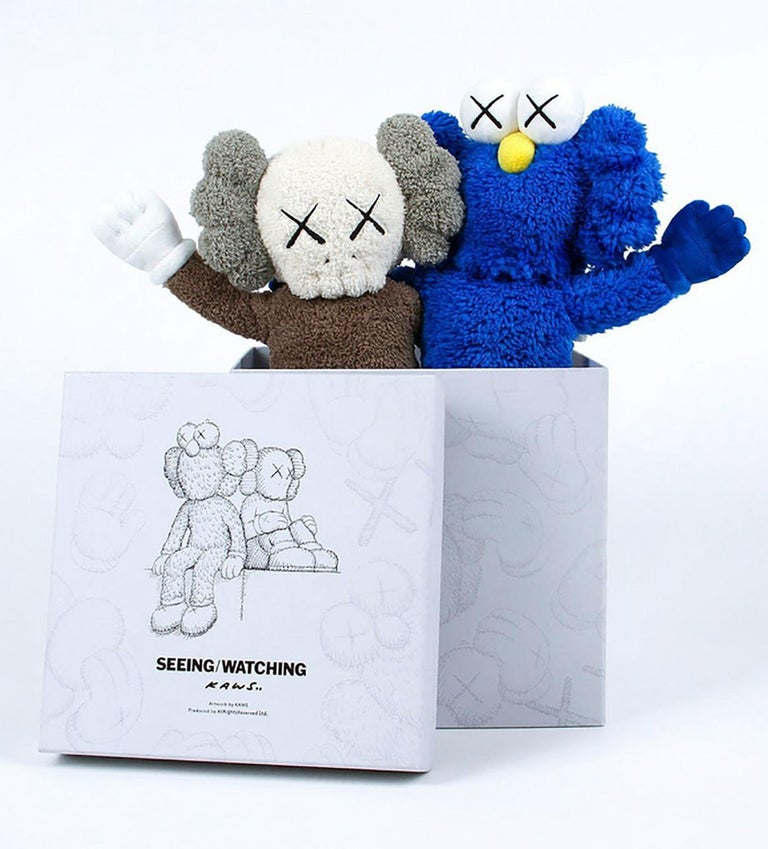 KAWS Seeing/Watching 2018 (KAWS Plush): New in original packaging accompanied by a numbered tag. Released in conjunction with the installation of the KAWS Seeing/Watching sculpture in Hunan, China. The plush figurines feature the well known
